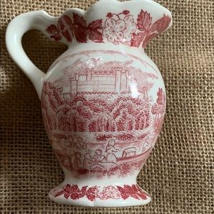 Transferware. red pitcher and brown pitcher
